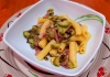 Rigatoni con pancetta, cipolla e zucchine